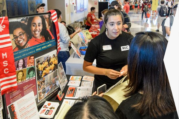 Students talking to organizations at the Student Org Fair